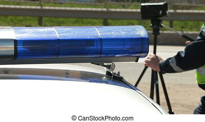 Officer Using Radar Speed Gun - Police Officer Using Radar...