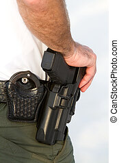 Officers Weapons - Police officer rests his hand on his...