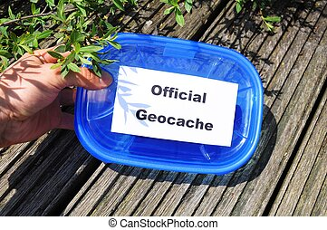 official geocache - official blue geocache box in nature or...