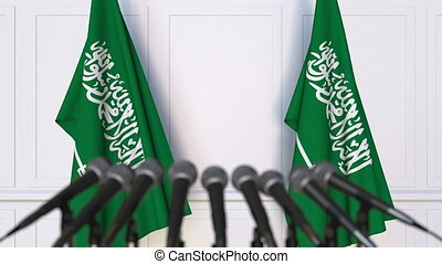 Official press conference. Flags of Saudi Arabia and...