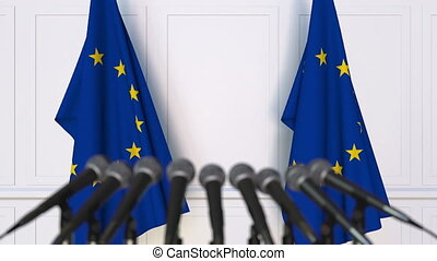 Official press conference. Flags of the European Union EU...