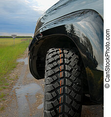 Offroad - 4x4 car on muddy wet road. All terrain kind of...