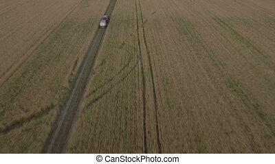 Offroad car on wheaten field