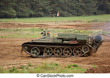 offroad scenery with driving tank - old tank of the...