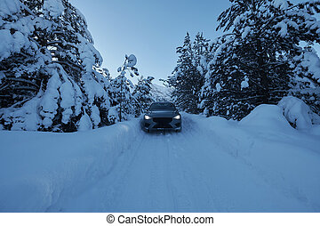 offroad suv car on icy winter north road