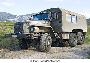 Offroad russian truck Ural against the background of Ural mountains