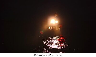 Offshore crewboat during night crewchange on offshore oilfield. FPSO tanker vessel near Oil platform Rig. Offshore oil and gas industry, sea oil production and storage