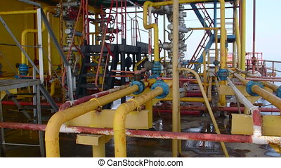 Offshore gas and oil production platform series of pipes, gauges and valves