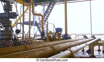 Offshore gas production platform components series of pipes, gauges and valves pan shot