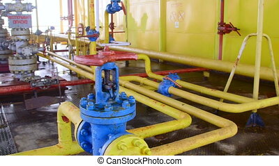 Offshore gas and oil production platform series of pipes, gauges and valves in the East-Kazantip field, pan shot