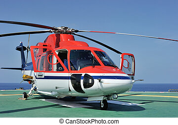 Offshore helicopter - An offshore helicopter parking at an...