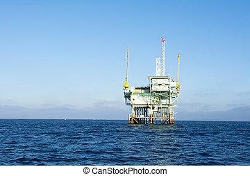 Offshore oil platform - An offshore oil platform rests in...