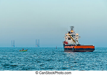 Offshore supply vessel sailing out - Offshore supply boat...