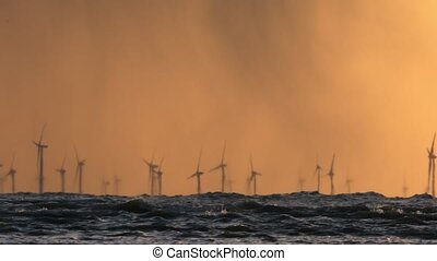 Offshore wind farm during sunset in Baltic sea. Renewable...