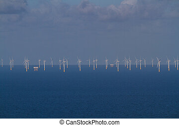 Offshore Wind Turbines out at sea from distance. - Wind ...