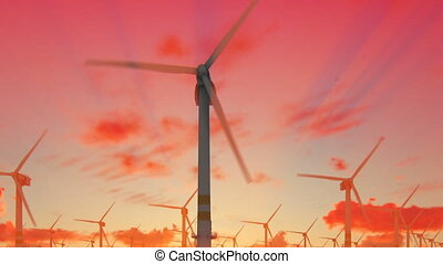 Offshore windmills against beautiful sunrise