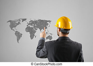 Offshoring and outsourcing concept - relocation of manufacturing processes to a lower-cost destination.