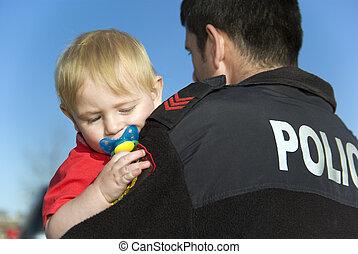 oficial de policía, asideros, bebé