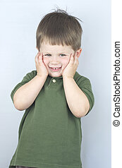 """Little boy with his hands on his face looking like he is saying """"Oh no!"""""""