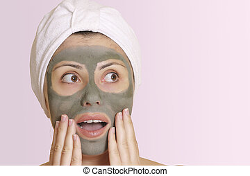 Oh no, my date is here already! Oh my, thats cheap! Woman in mask looks sideways