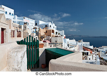 Oia at Santorini island in Greece - Traditional village of...
