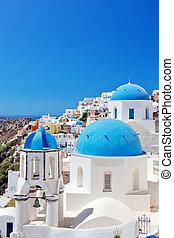 Oia town on Santorini island, Greece. Caldera on Aegean sea...