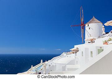 Oia town on Santorini island, Greece. Famous windmills on ...