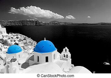 Oia town on Santorini island, Greece. Blue dome church,...