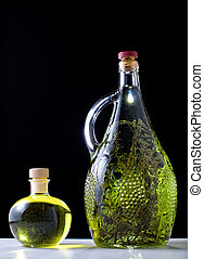 Oil and brandy - Olive oil and herb brandy on a black...