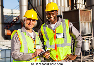 oil and chemical co-workers in plant - oil and chemical...