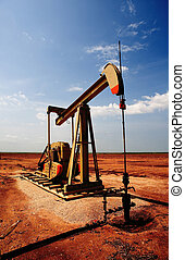 Oil and Gas - An oil pump or pumpjack on the plains of west ...