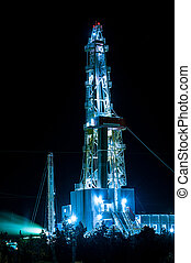 Oil and Gas Drilling Rig at night. Oil drilling rig operation on the oil platform.