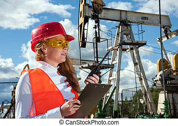 Oil and gas industry engineer. - Woman engineer in yellow...