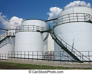 Oil and gas industry. Oil reservoir and storage tank of mineral oil