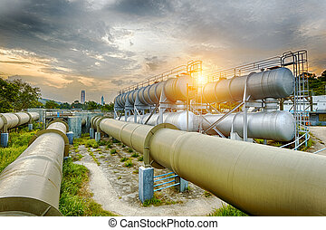 Oil and gas industry refinery factory at sunset