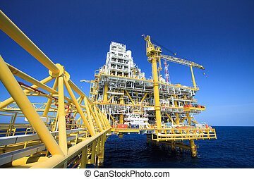 Oil and gas platform in offshore industry, Production process in petroleum industry, Construction plant of oil and gas industry. heavy work.