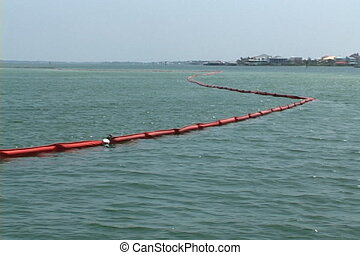 Oil Booms - Oil booms designed and anchored in the water to...