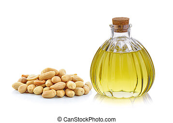 Oil bottle and peanuts on white background