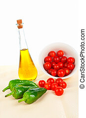 Oil bottle, red tomatos cherry and green pepper