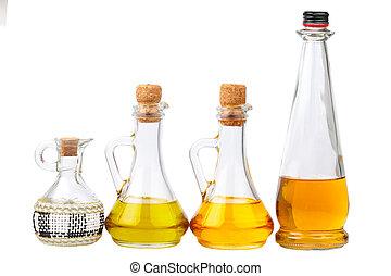 Oil bottles on white