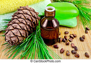 Oil cedar with pine cones and soap - Cedar oil in a bottle,...