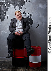 upset caucasian man is saddened by oil prices - oil. concept...