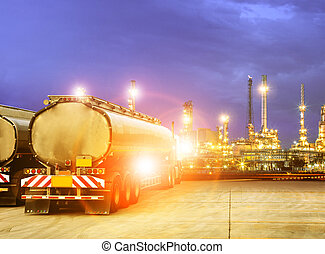oil container truck and beautiful lighting of oil refinery plant