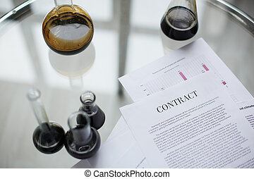 Oil contract - Test-tubes with liquid oil over contract in...