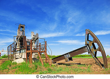 oil crisis - abandoned oil pump jack in field