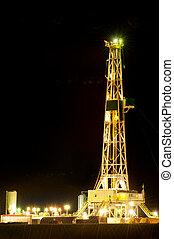 Oil derrick at night on Oklahoma plains