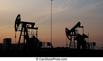 Oil drill rig and pump jack. Petroleum production, natural gas.