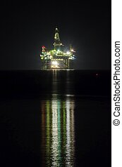 A night view of the oil drilling platform lit up on the coast of Limassol, in Cyprus. The oil rig is floating in the Mediterranean sea and is ready for drilling for natural gas appraisal.