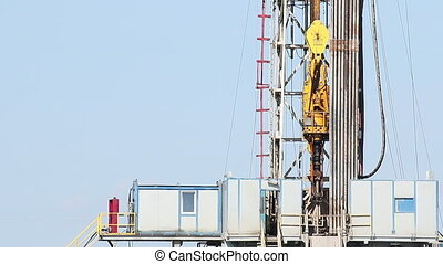 oil drilling rig with workers