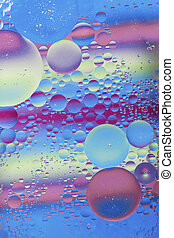 Oil drops in water macro with a colorful background